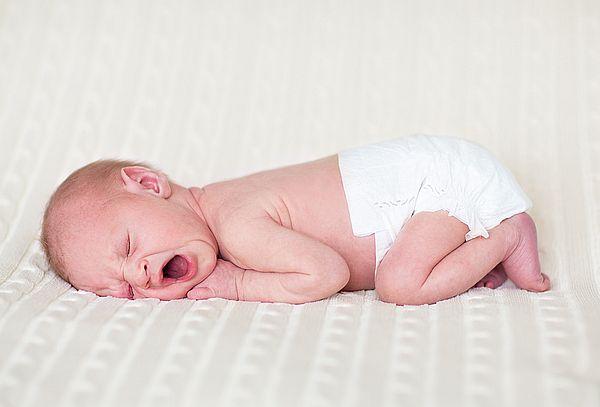 симптомы колик у новорожденных