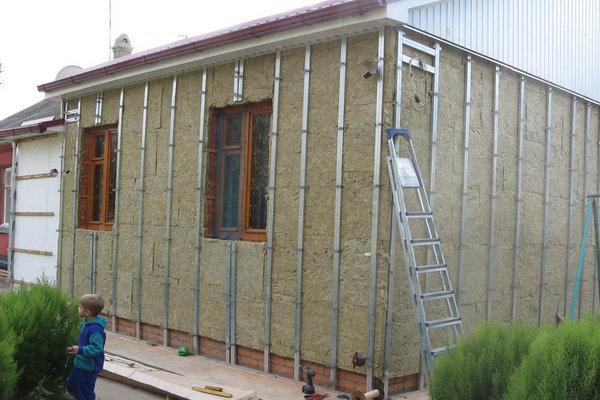 Утепление деревянного дома под сайдинг